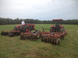 Both tractors have disks attached ready to prepare the food plots.